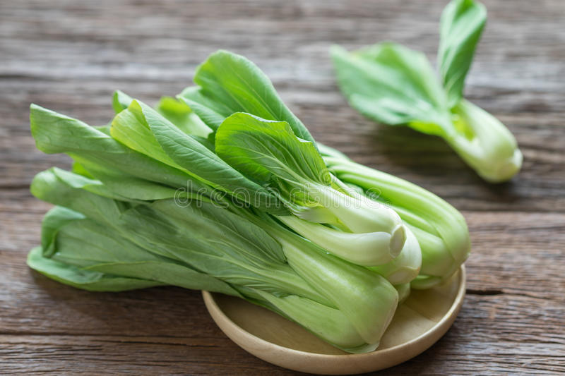 Bok choy chinese cabbage on wooden table. Bok choy chinese cabbage on wooden table royalty free stock photos
