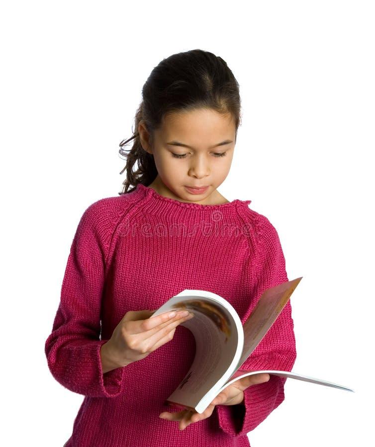 bok som bläddrar flickan henne som är ung arkivfoton