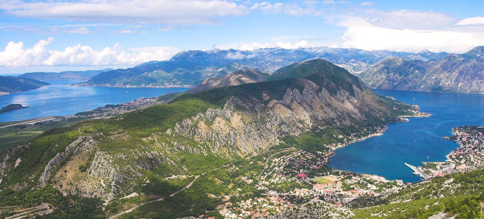 Boka Kotorska bay panorama. From the mountain above it showing also mountains and cities surrounding it royalty free stock image