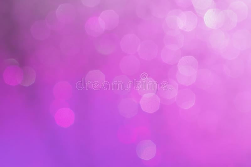 Bokeh abstract texture. Beautiful christmas background in purple stock image