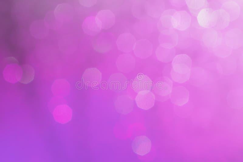 Bokeh abstracte textuur Mooie Kerstmisachtergrond in purple stock afbeelding