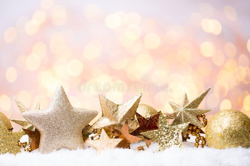 Bokeh abstrato do ouro Fundo do tema do Natal e do ano novo imagens de stock