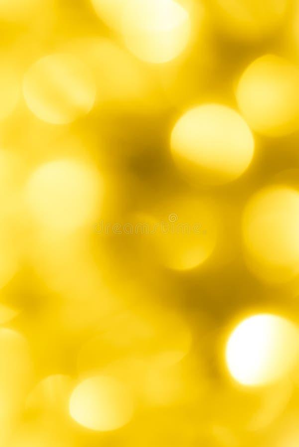 Bokeh amarelo festivo bonito Fundo fotografia de stock