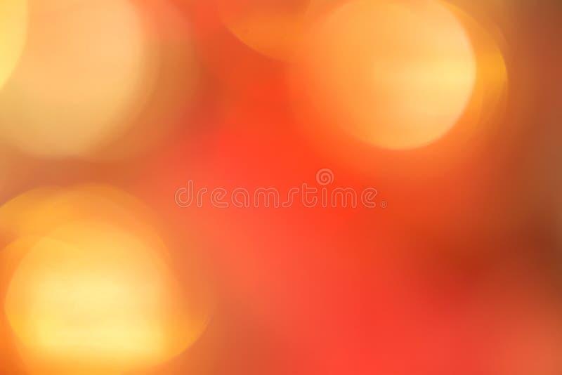 Bokeh anaranjado y rojo El fondo con el boke Textura abstracta imagen de archivo libre de regalías