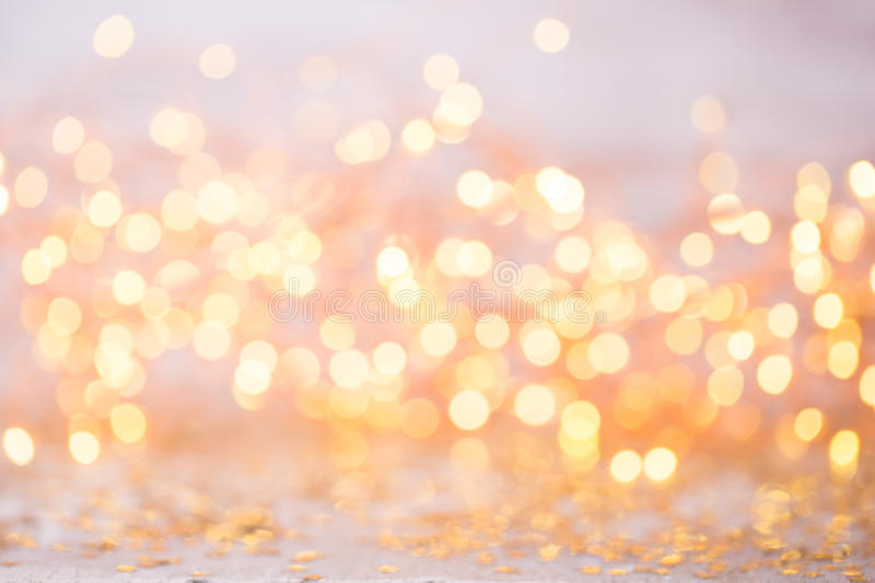 Bokeh astratto dell'oro Fondo di tema del nuovo anno e di Natale immagine stock