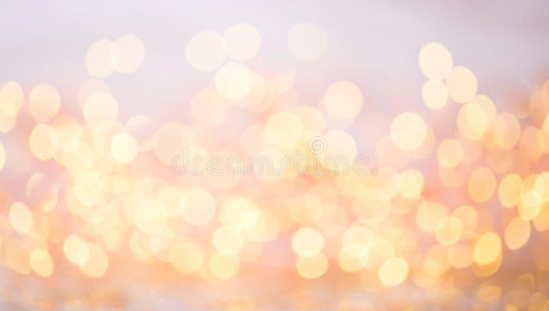 Bokeh astratto dell'oro Fondo di tema del nuovo anno e di Natale immagine stock libera da diritti