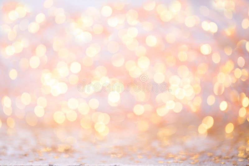 Bokeh astratto dell'oro Fondo di tema del nuovo anno e di Natale fotografia stock