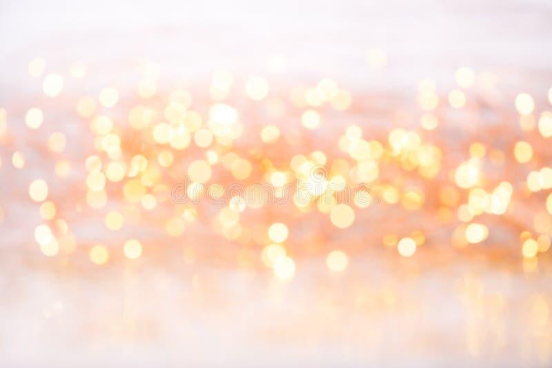 Bokeh astratto dell'oro Fondo di tema del nuovo anno e di Natale fotografie stock
