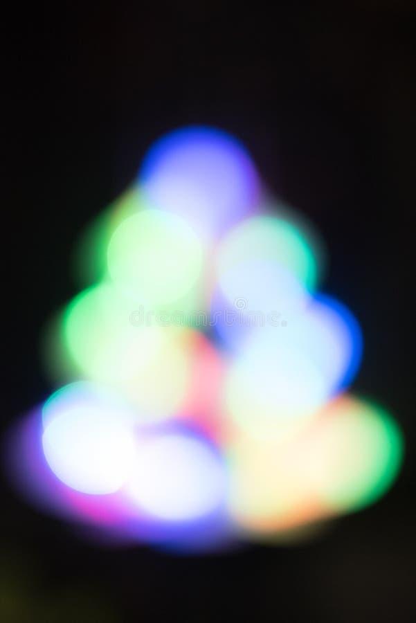 Bokeh astratto della luce notturna dell'albero di Natale, fondo defocused fotografia stock libera da diritti