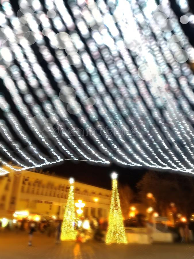 Bokeh background with city Christmas decorations. Bokeh background with outdoor Christmas lights decoration in the city of Timisoara, Romania royalty free stock images