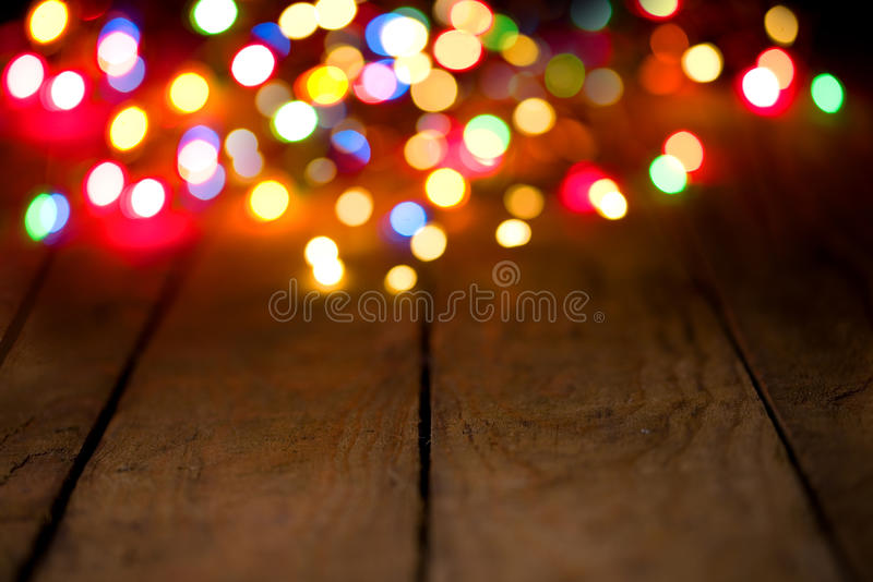 Bokeh background with colorful lights on wooden boards. Bokeh background with colorful lights on wooden planks stock photography