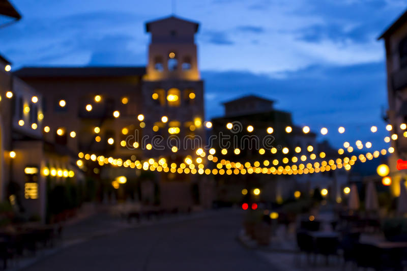 Bokeh background created from picture of decorate light in town square on evening time. Can be use as background for Christmas cel royalty free stock images