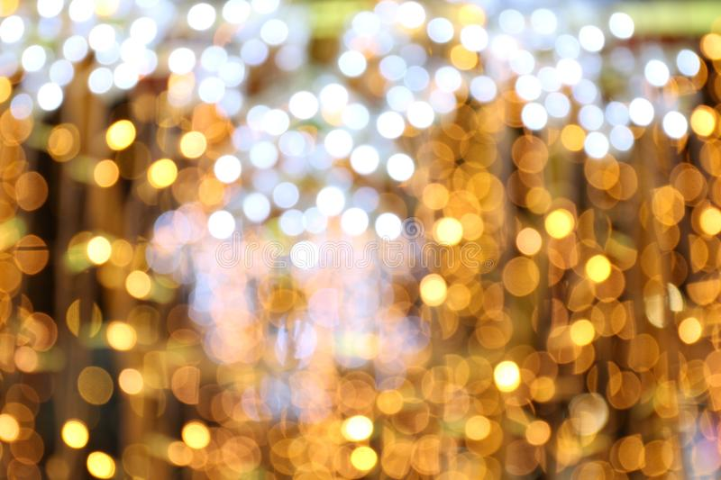 Bokeh background gold yellow colorful of merry christmas, Happy new year bokeh lighting shine on night background, Bokeh glitter royalty free stock photography