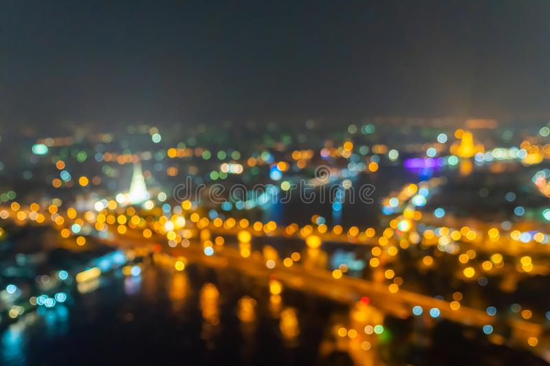 Bokeh background of skyscraper buildings in city with lights, Blurry photo at night time. 4K cityscape VDO royalty free stock photo