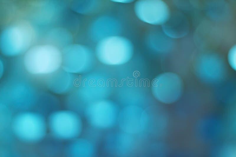 Bokeh blu, struttura defocused astratta del fondo immagini stock libere da diritti