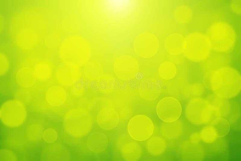 Bokeh blurly bianco verde del fondo della luce dell'estratto del bokeh su fondo giallo e verde fotografia stock