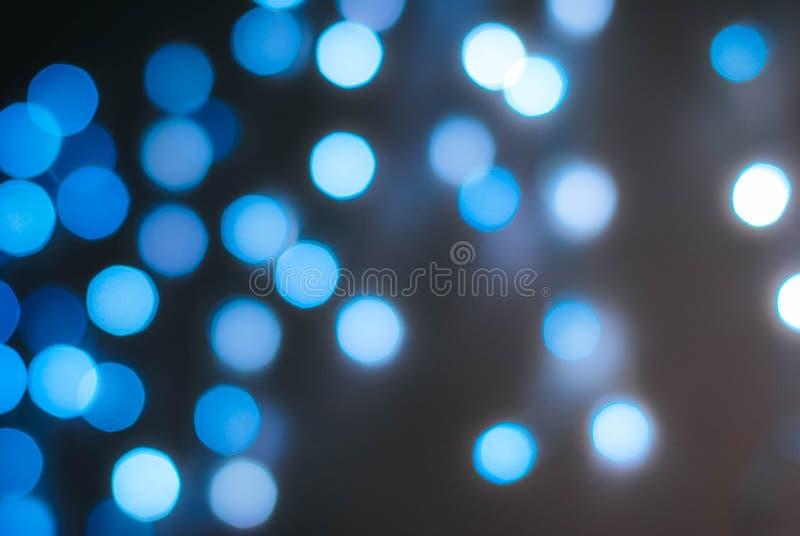 Bokeh brilhante de luzes azuis fotografia de stock royalty free