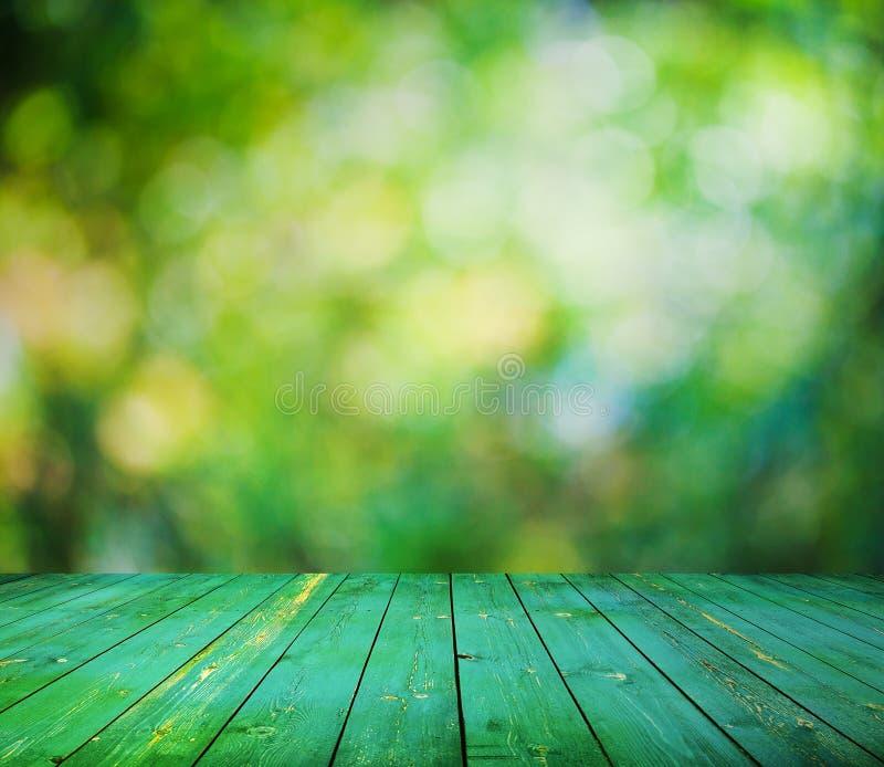 Bokeh brilhante e assoalho de madeira fotos de stock