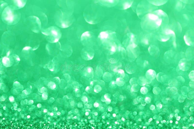 Bokeh brillant de lumières de defocus de scintillement vert abstrait photos libres de droits