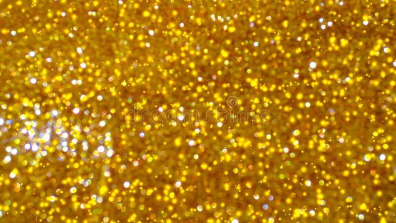 Bokeh brillante dorato dell'estratto su fondo tinto leggero Fondo d'ardore con stile del bokeh per i saluti stagionali fotografia stock libera da diritti