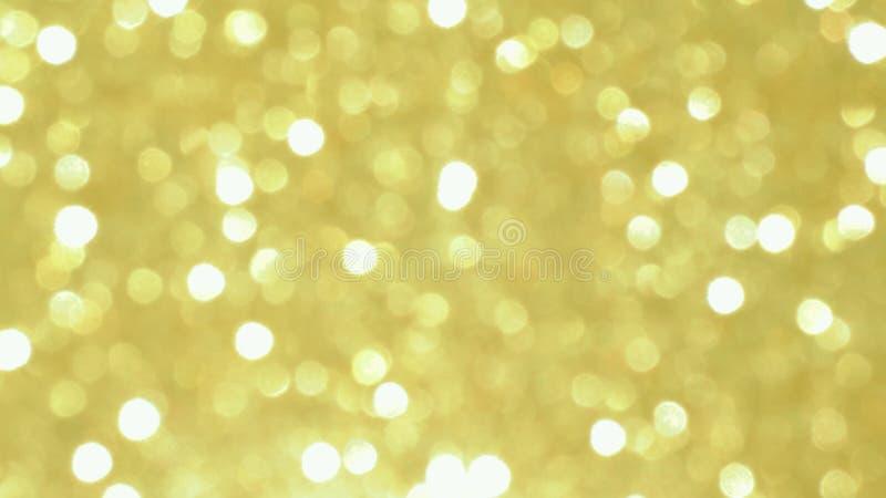 Bokeh brillante dorato dell'estratto su fondo tinto leggero Fondo d'ardore con stile del bokeh per i saluti stagionali fotografia stock