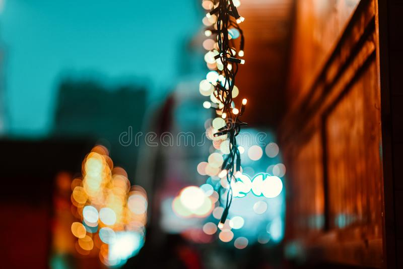 New years and Christmas ambience. Bokeh. Candle light closeup with Bokeh background. Happy New years and Christmas celebration concept. Candles hanging from a royalty free stock images
