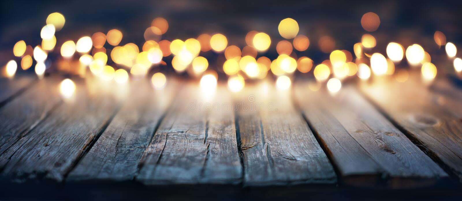 Bokeh Of Christmas Lights. On Vintage Wooden Plank