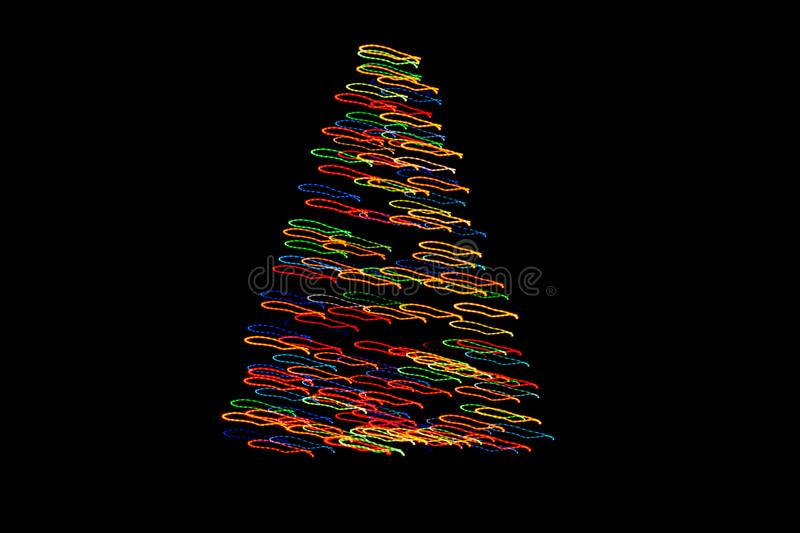 Bokeh Christmas tree with colorful lights. Pine on black background royalty free stock photography