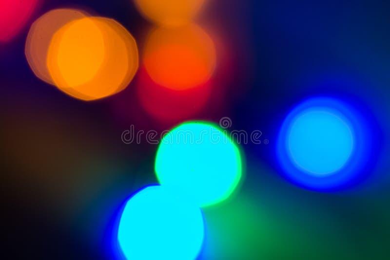 Bokeh coloreado circular sobre fondo oscuro imagen de archivo libre de regalías