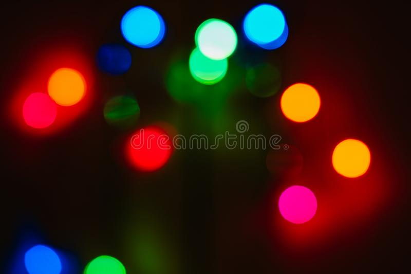Bokeh colored on black background. Abstract, blue, blur, blurred, bright, christmas, colorful, design, effect, glitter, glow, glowing, gold, light, night royalty free stock images