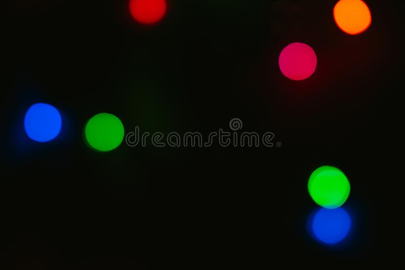 Bokeh colored on black background. Abstract, blue, blur, blurred, bright, christmas, colorful, design, effect, glitter, glow, glowing, gold, light, night stock image