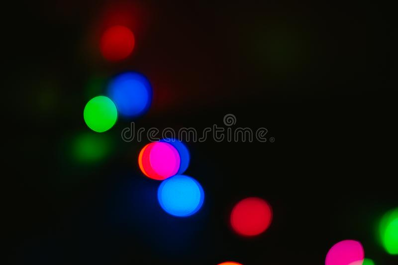 Bokeh colored on black background. Abstract, blue, blur, blurred, bright, christmas, colorful, design, effect, glitter, glow, glowing, gold, light, night stock photos