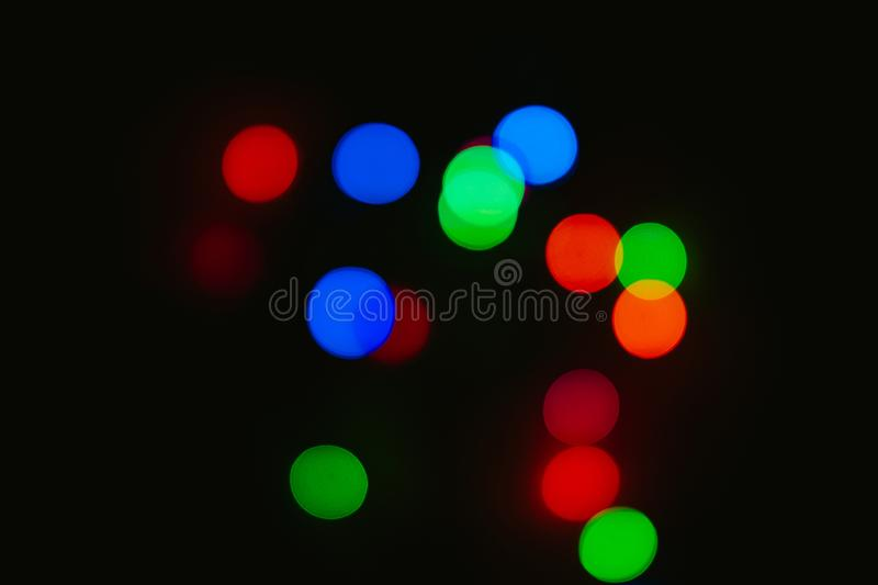 Bokeh colored on black background. Abstract, blue, blur, blurred, bright, christmas, colorful, design, effect, glitter, glow, glowing, gold, light, night royalty free stock photography