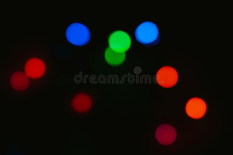 Bokeh colored on black background. Abstract, blue, blur, blurred, bright, christmas, colorful, design, effect, glitter, glow, glowing, gold, light, night stock images
