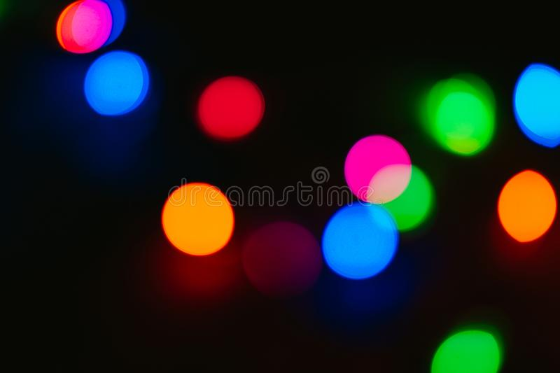 Bokeh colored on black background. Abstract, blue, blur, blurred, bright, christmas, colorful, design, effect, glitter, glow, glowing, gold, light, night royalty free stock photo
