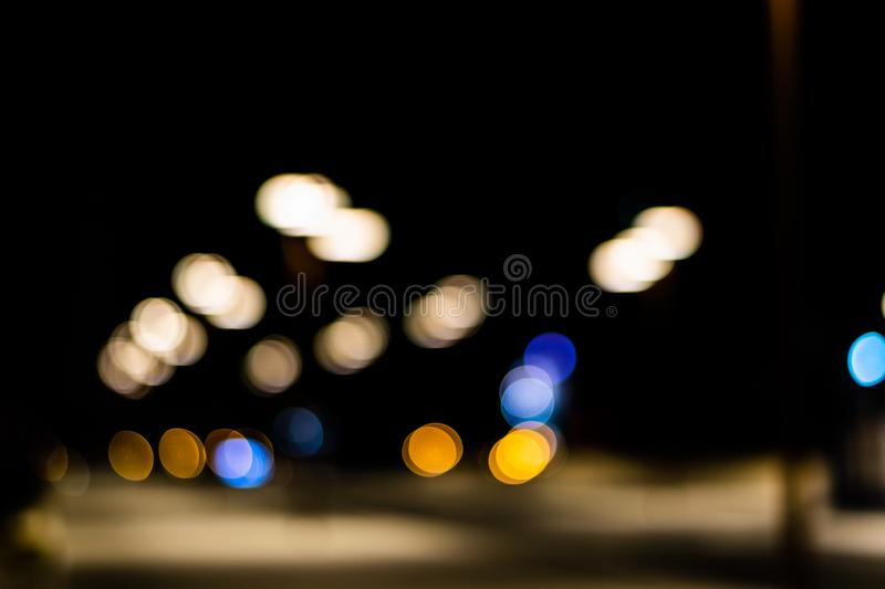 Bokeh colored on black background. Abstract, blue, blur, blurred, bright, christmas, colorful, design, effect, glitter, glow, glowing, gold, light, night royalty free stock photos