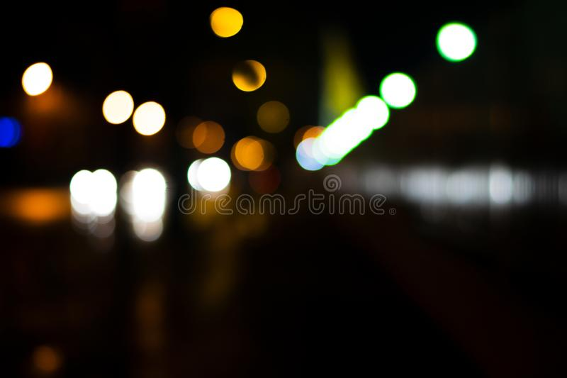 Bokeh colored on black background. Abstract, blue, blur, blurred, bright, christmas, colorful, design, effect, glitter, glow, glowing, gold, light, night stock photography