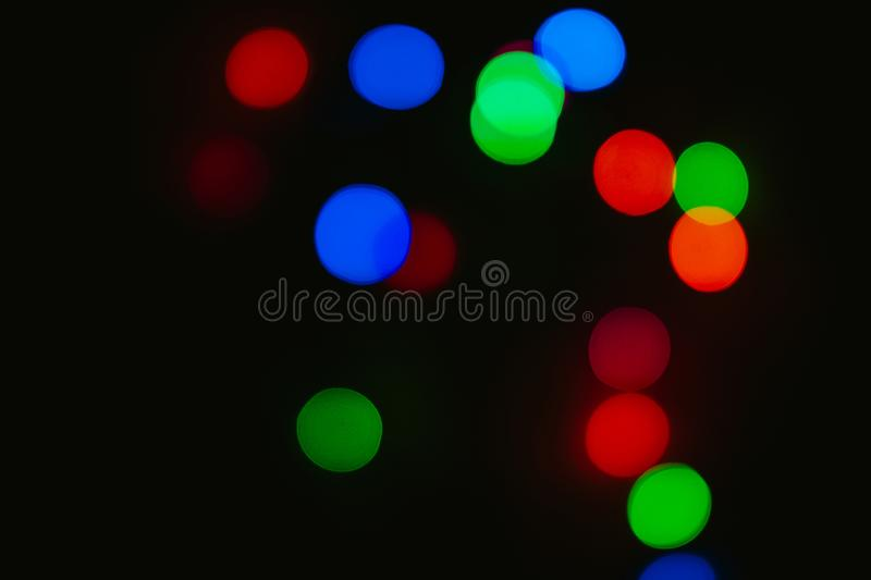 Bokeh colored on black background. Abstract, blue, blur, blurred, bright, christmas, colorful, design, effect, glitter, glow, glowing, gold, light, night royalty free stock image