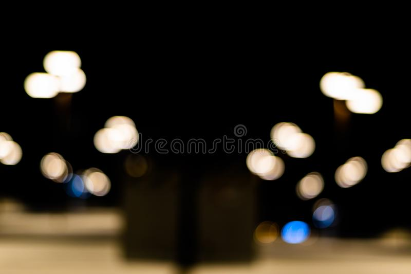 Bokeh colored on black background. Abstract, blue, blur, blurred, bright, christmas, colorful, design, effect, glitter, glow, glowing, gold, light, night stock photo