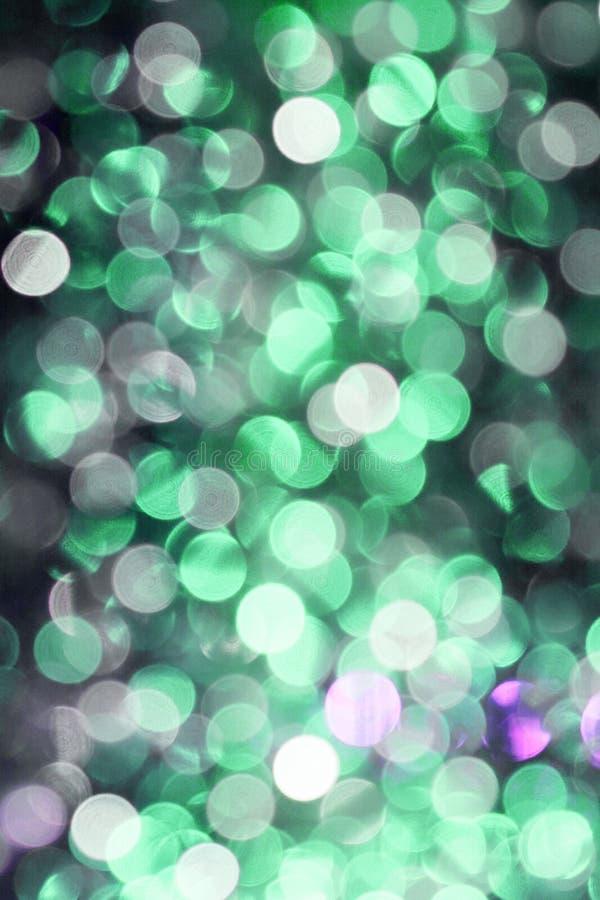 Bokeh colourful astratto Unfocused su fondo nero defocused e vago molti intorno a luce immagine stock