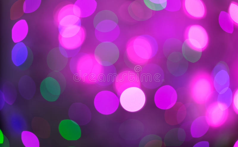 Bokeh cor-de-rosa e roxo do feriado Fundo abstrato do Natal foto de stock