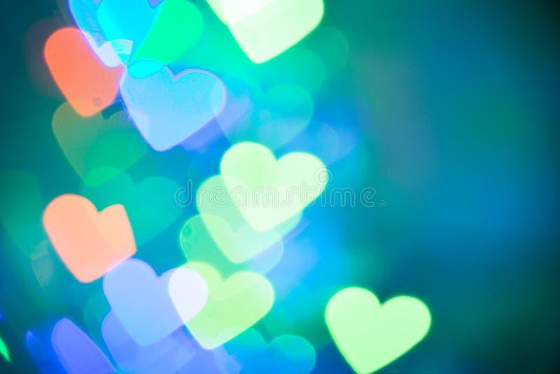 Bokeh de coeurs en tant que fond de Saint Valentin de fond photographie stock