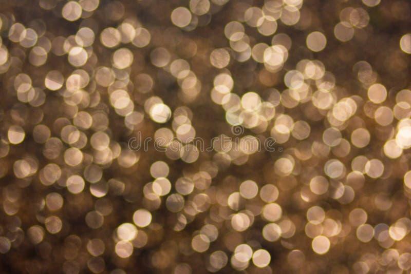 Bokeh de fête d'or image stock