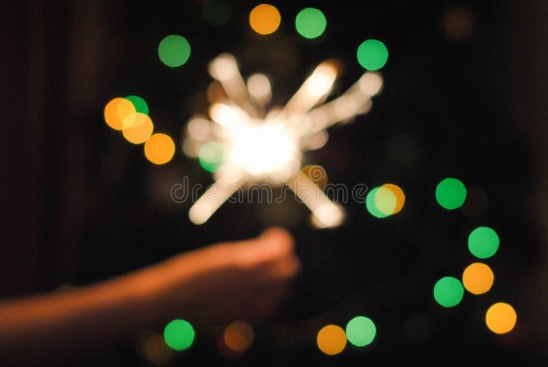 Bokeh de guirlande et de cierges magiques de Noël image stock