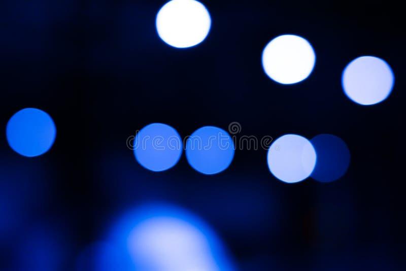 Bokeh de la imagen de fondo en el camino en la noche fotografía de archivo