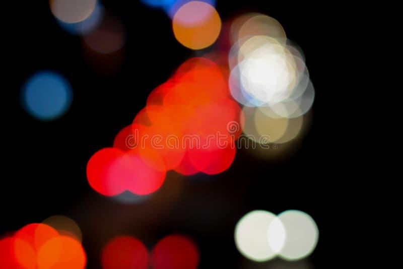 Bokeh de la imagen de fondo en el camino en la noche foto de archivo libre de regalías