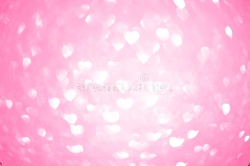 Bokeh del corazón en fondo rosado imágenes de archivo libres de regalías