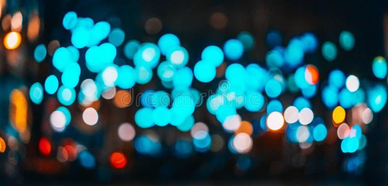 Bokeh della sfuocatura della luce notturna della città, fondo defocused fotografie stock libere da diritti