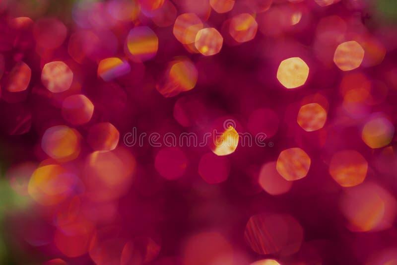 Bokeh di scintillio di struttura della sfuocatura del fondo, viola, giallo, rosa, rosso, sei lati, giro royalty illustrazione gratis
