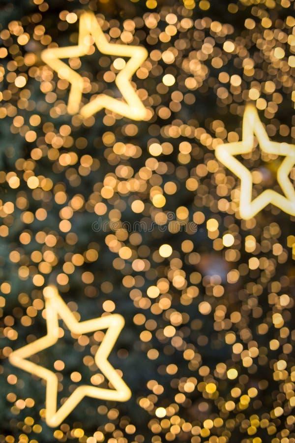 Bokeh e estrela Defocused Abstra morno claro do bokeh do tom do twinkling foto de stock royalty free